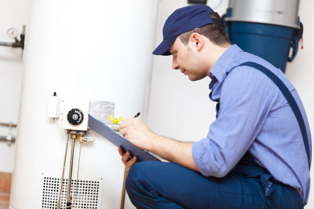 tech troubleshooting water heater
